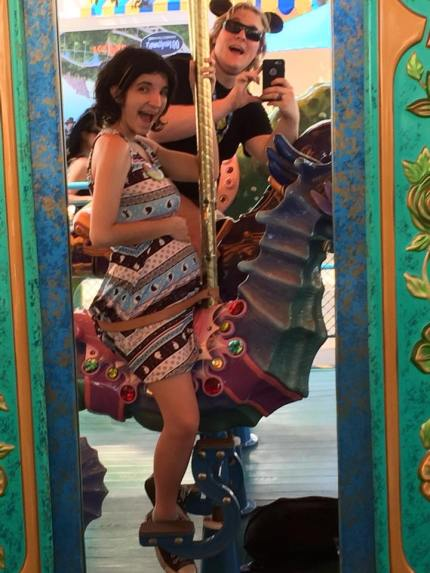 disneyland carousel pregnancy announcement maternity photo